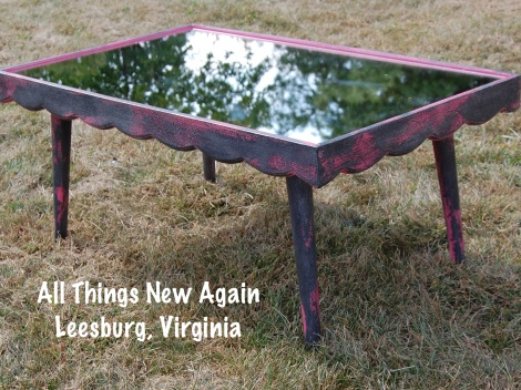 Punk Rock Princess Coffee Table ~ Painted with American Paint Company's Momma's Lipstick and Lincoln's Hat with swirls of silver mica. What? Hot pink, black and glitter doesn't match your living room decor? No worries! This would also look great as a bedside table or at the foot of a bed in a young lady's room.