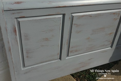 Headboard painted with Dixie Belle Paint's new color Manatee Gray and heavily distressed